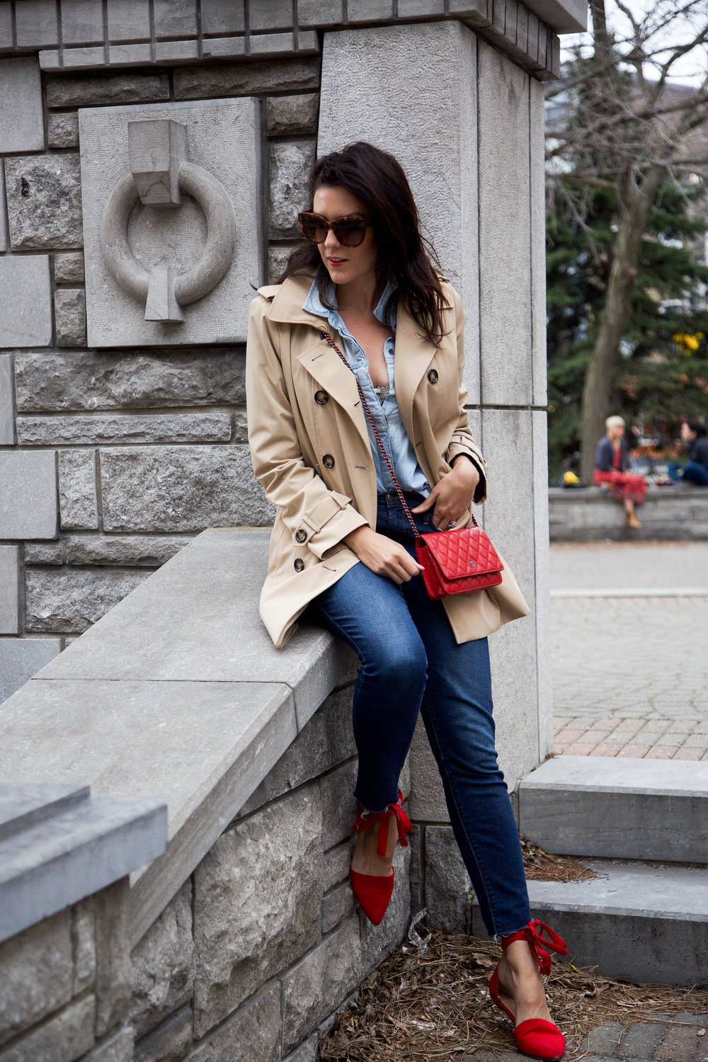 denim-on-denim-outfit-with-trench-coat-and-red-accessories.jpg