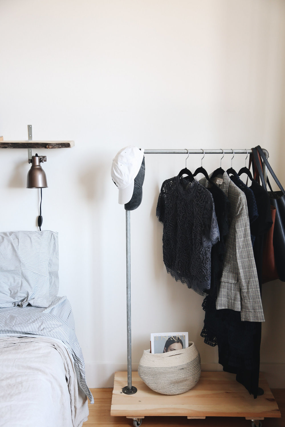 To the right of our bed, you can find a small clothing rack (handmade by Mr.RC, but similar one  here ), where I like to keep seasonal items and/or my latest purchases. The  H&M basket  was purely for decoration.
