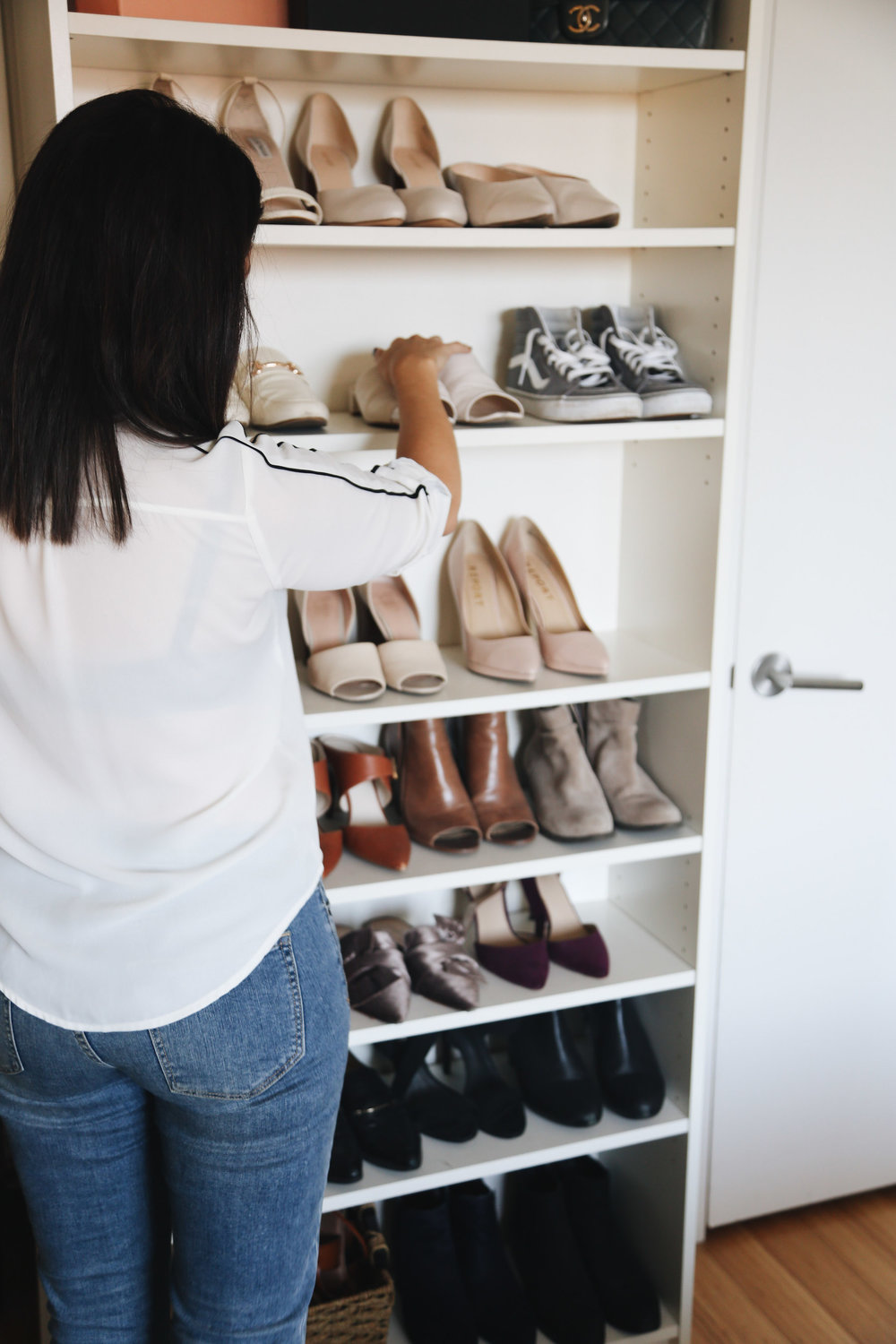 Because closet space was minimal, I used a basic Ikea bookshelf to display some of my shoes and (not pictured) Chanel bags.