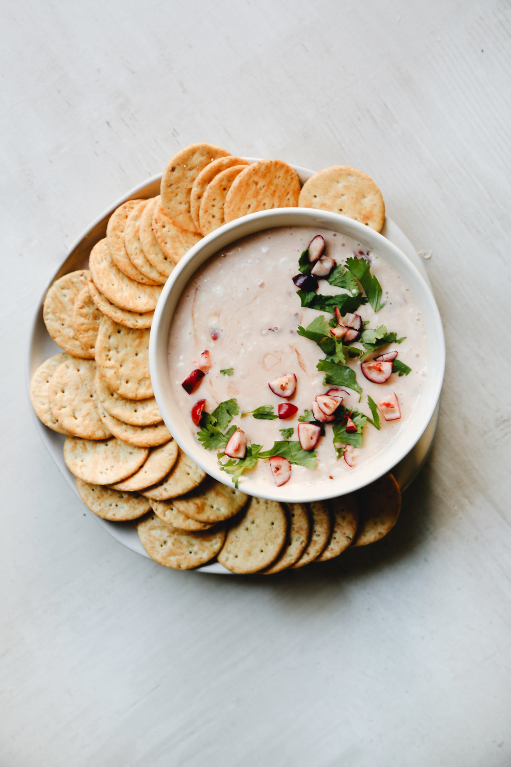 PEPPER JELLY + CREAM CHEESE DIP - Pepper jelly + cream cheese is nothing new. In fact, it's been around for longer than I've probably been alive. And yet, it's just too good to give it up (even if it is something grandma would make). This easy spin on the classic (simply beat the cream cheese and pepper jelly together instead of pouring the pepper jelly on top of the cream cheese) is a fun way to modernize the recipe just a bit. Add in orange zest or a splash of tabasco for another twist, and garnish with pomegranate seeds or chopped fresh cranberries and fresh herbs (I like cilantro). This dip will need to chill for at least a few hours, if not overnight, so it's perfect for make ahead situations (just wait to add the garnishes until right before serving).