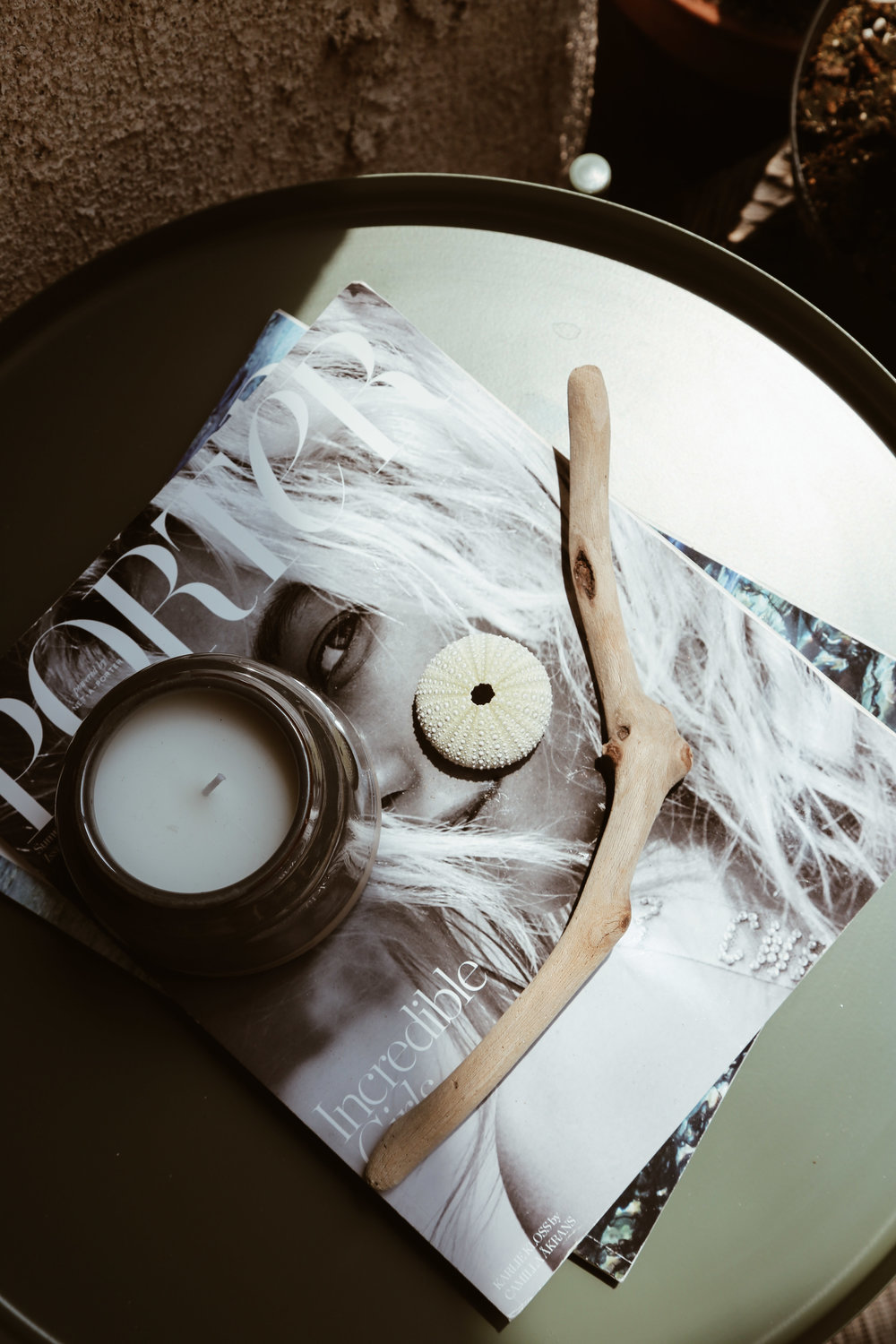 simple table top style with porter magazine and shells.jpg