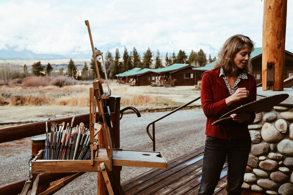 Kathryn Turner painting on her family's ranch, Triangle X