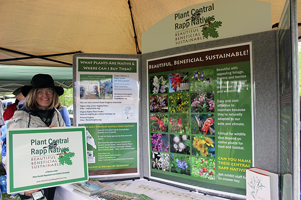 The Plant Central Rapp Natives Campaign was launched at the Fredricksburg Earth Day Festival on April 22!   - Nancy Vehrs, President of the Virginia Native Plant Society, shows one of the signs that will be provided to native plant providers participating in the marketing campaign.