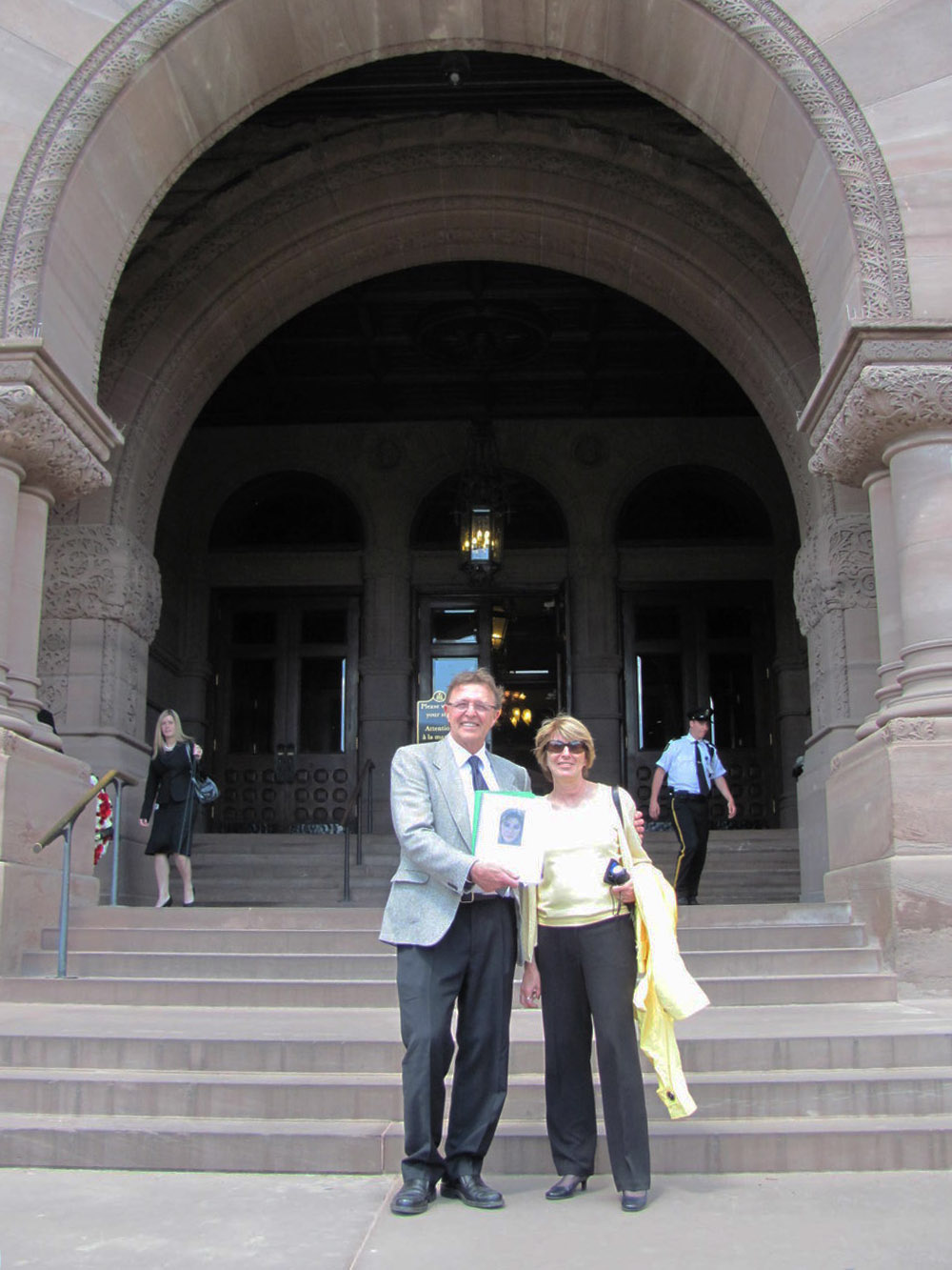 Ed and Dawn Novak present their document at Queen's Park, 2010.