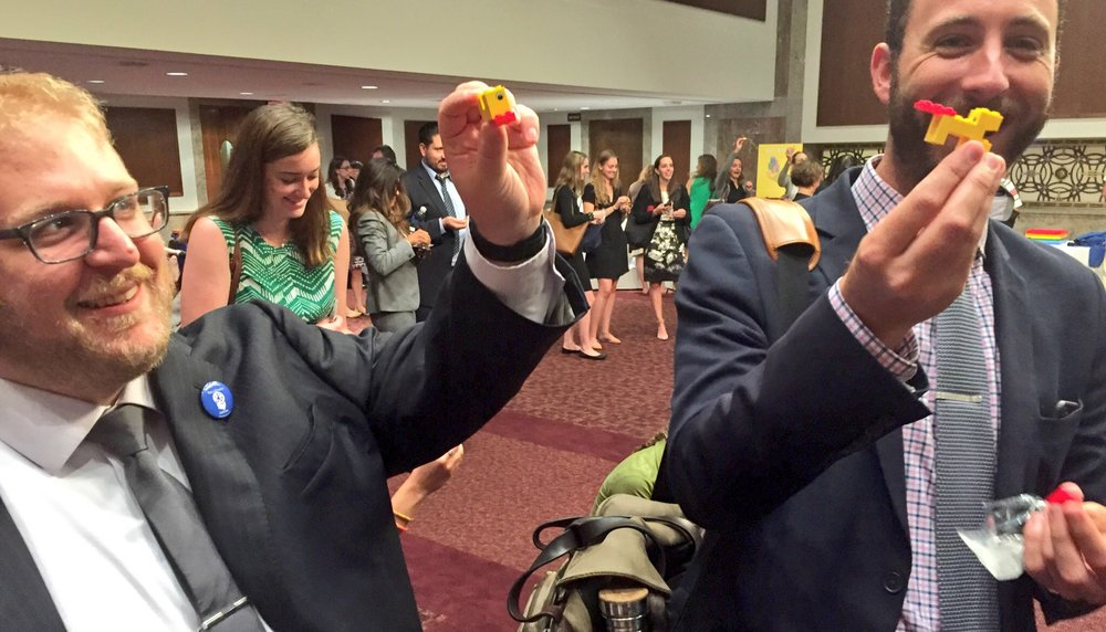 Government Relations Directors, Kevin (BEC) and Brian (GCE) making ducks at early childhood development Hill briefing, co-hosted with Lego