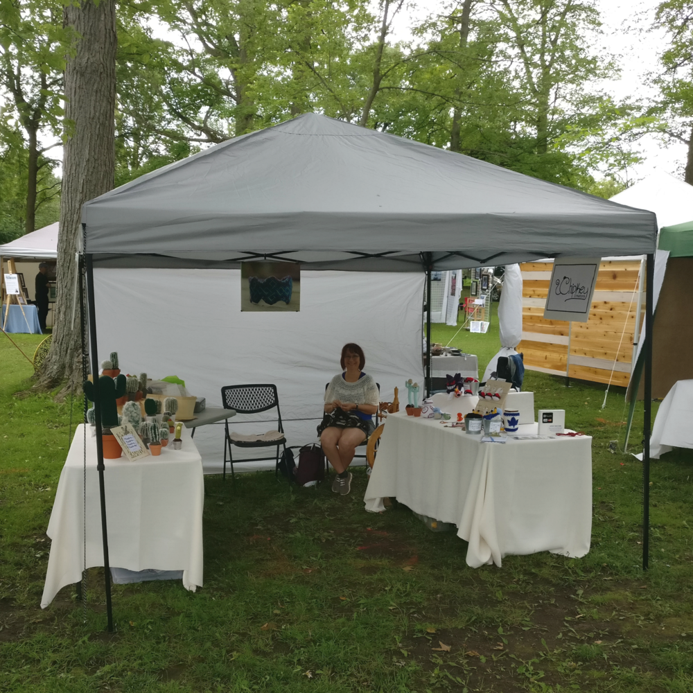 My mom and my booth at Uxbridge Art in the Park last summer