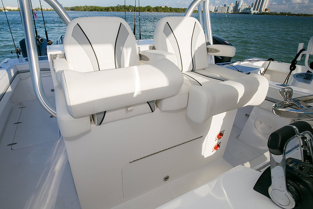 Deluxe helm seating for two with flip-up armrests and bolsters and battery access underneath (combination seating option)