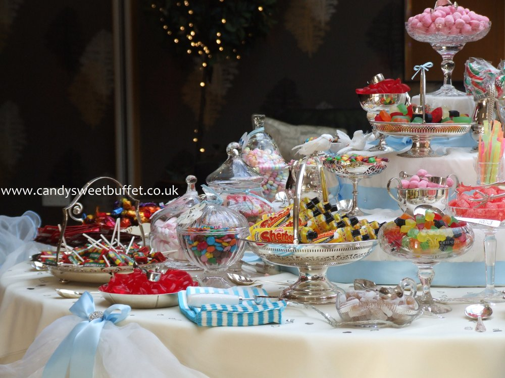 Candy cart or Luxury sweets and candy buffet table banquet