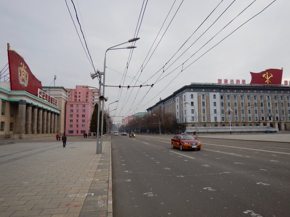 Sungri Street, one of the capital's widest roads, only sees minimal traffic due to the DPRK's low rate of vehicle ownership. (Photo by Ethan Jakob Craft.)