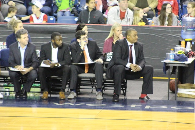 Niagara River Lions coaching staff, from left to right (Vito DiMartino, Grâce Lokole, Elliott Etherington, Keith Vassell) analysing their team's play. (Photo by Santiago Maynard.)