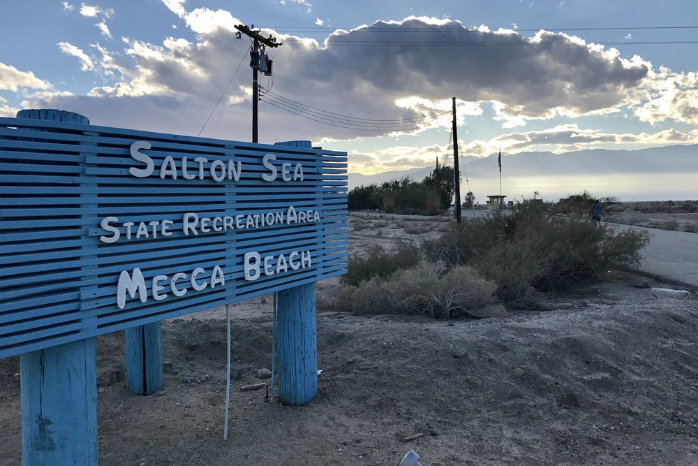 A newly restored sign welcomes visitors to the Salton Sea State Recreation Area at Mecca Beach on the Salton Sea's east coast on Jan. 6, 2017. (Photo by Ethan Jakob Craft.)