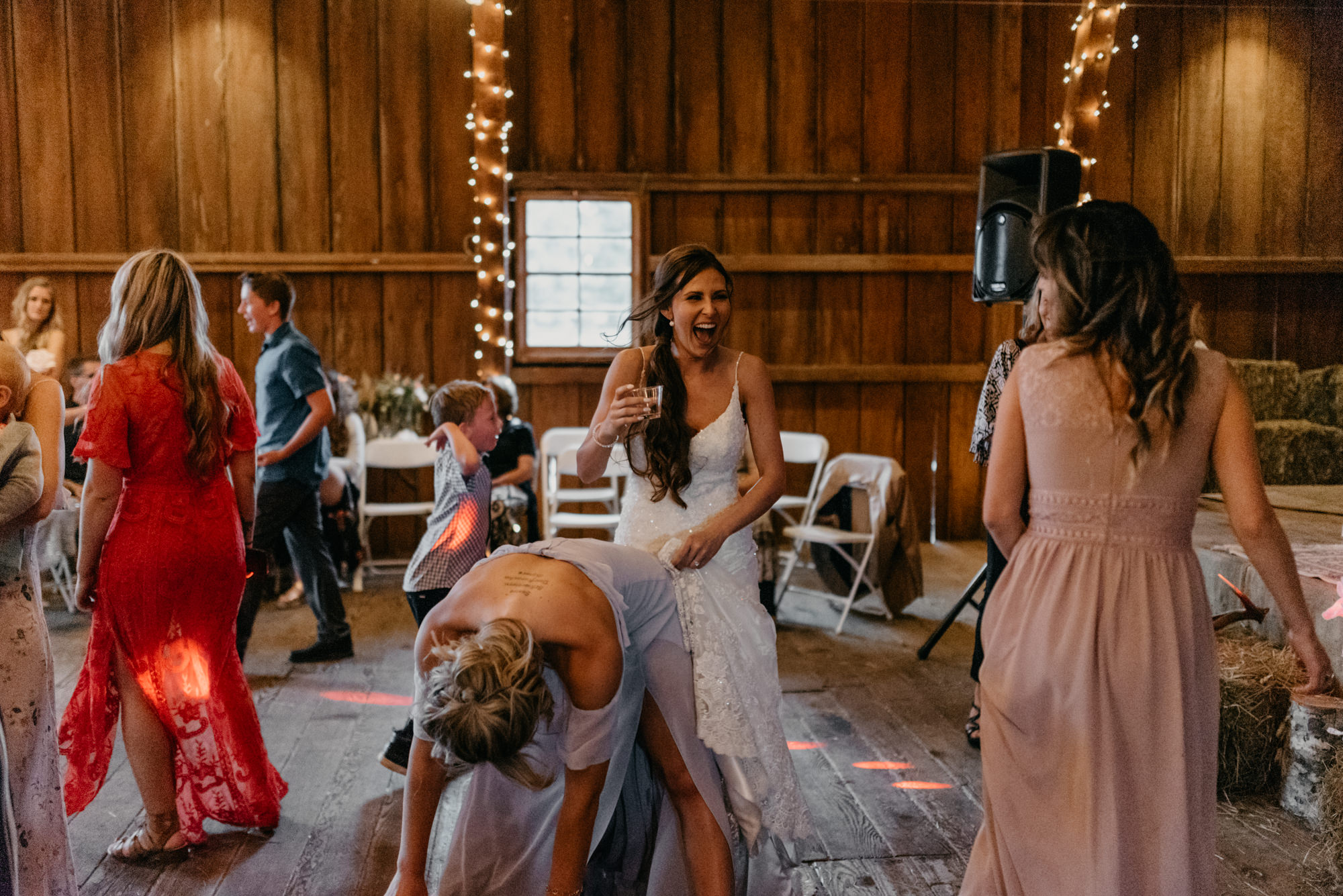 202-portland-northwest-wedding-bubble-exit-barn-string-lights.jpg