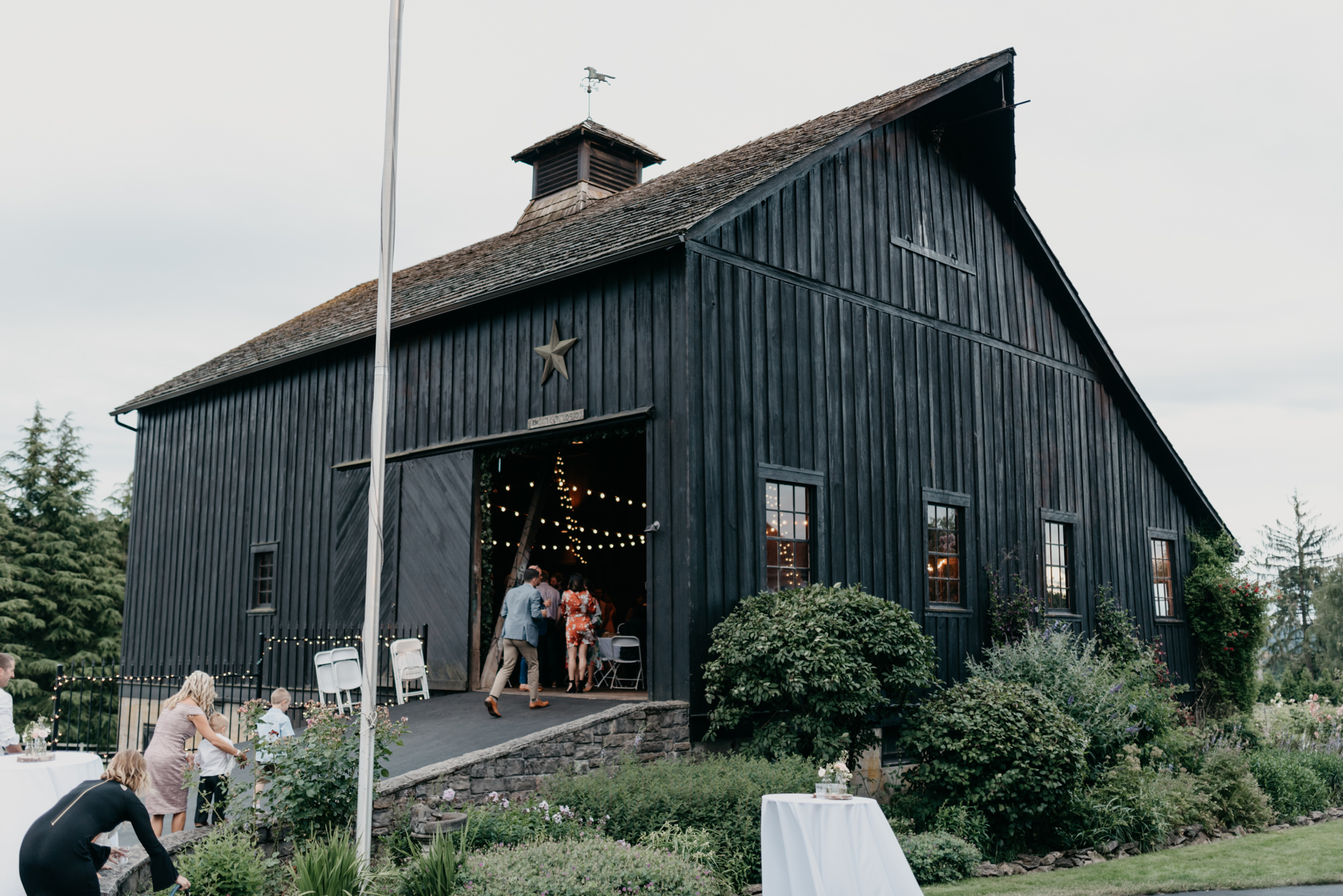 210-portland-northwest-wedding-bubble-exit-barn-string-lights.jpg