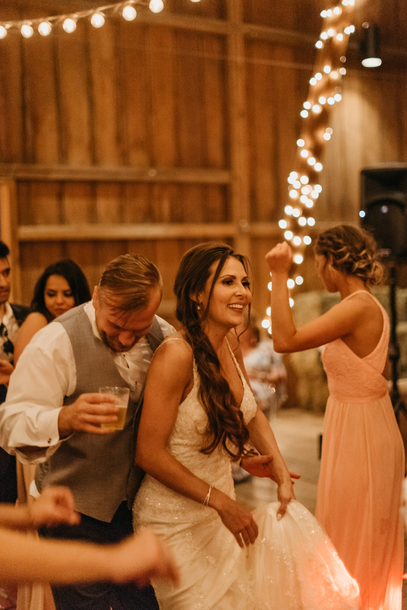 217-portland-northwest-wedding-bubble-exit-barn-string-lights.jpg