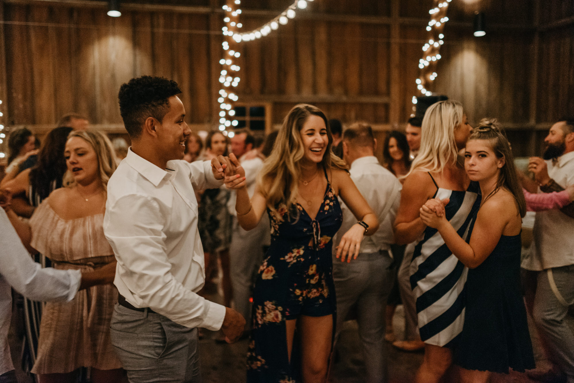 218-portland-northwest-wedding-bubble-exit-barn-string-lights.jpg