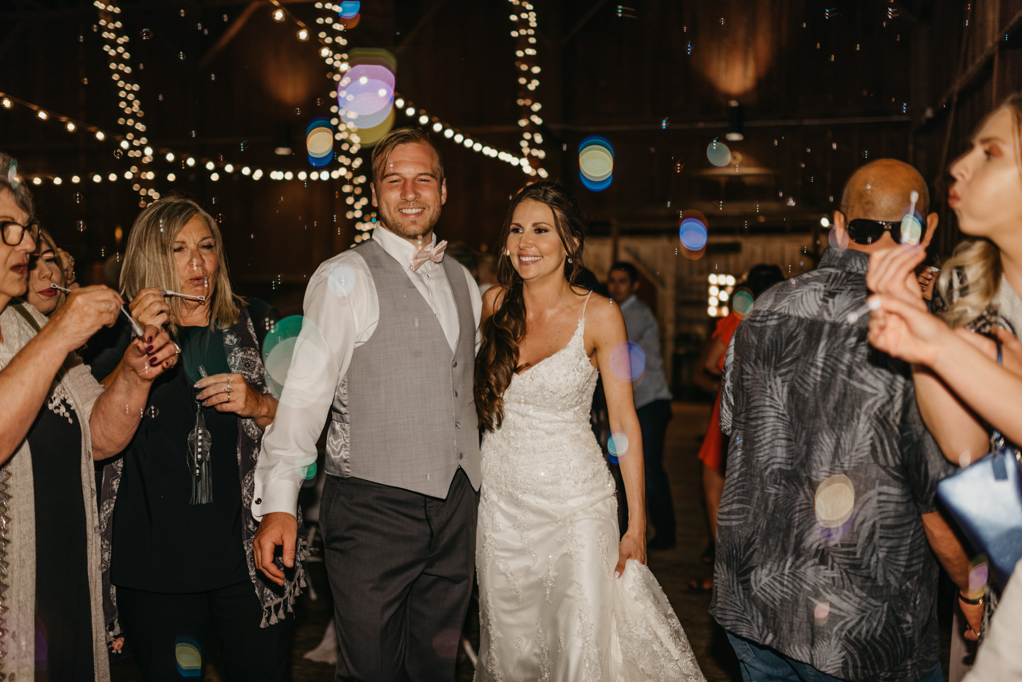 222-portland-northwest-wedding-bubble-exit-barn-string-lights.jpg