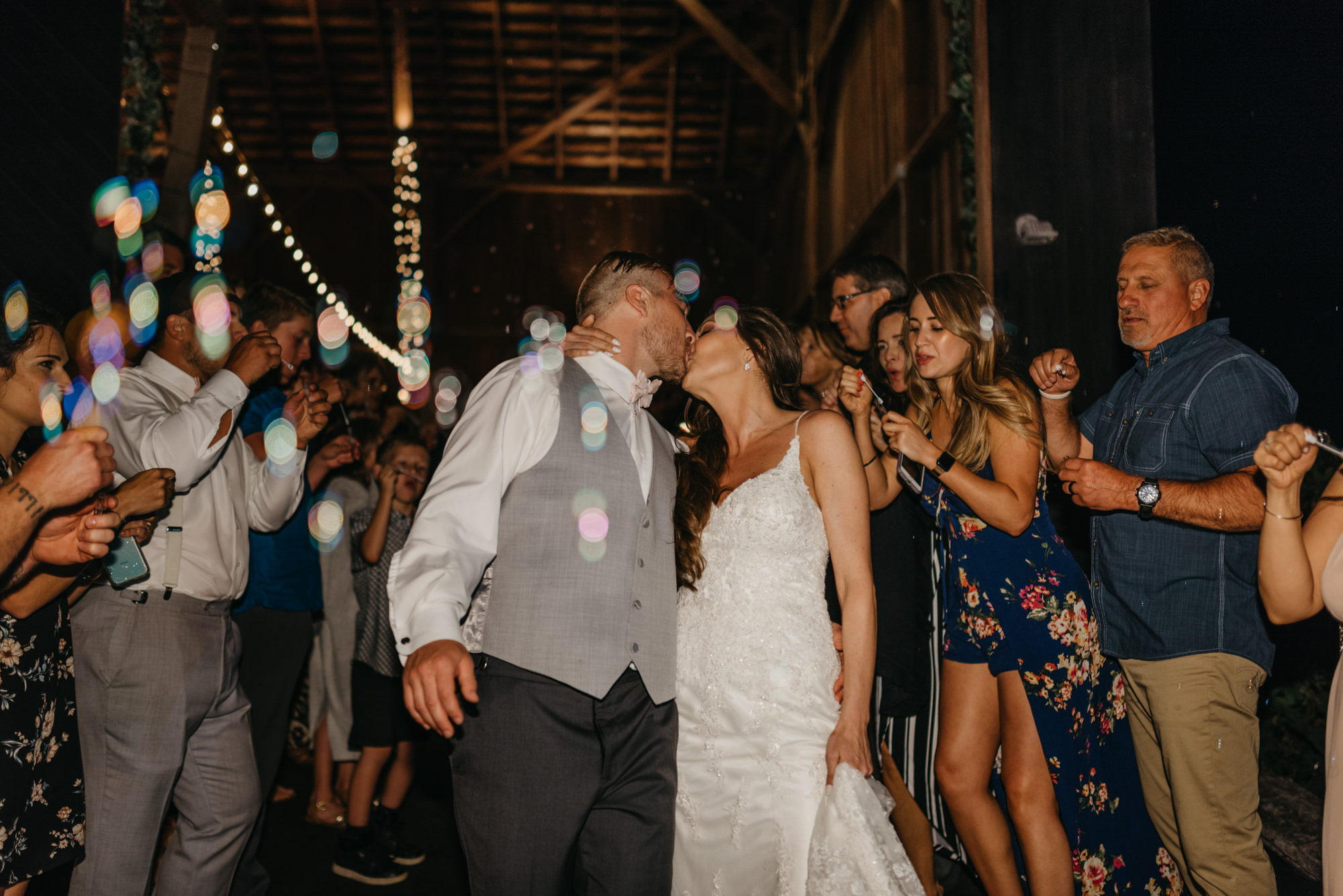 225-portland-northwest-wedding-bubble-exit-barn-string-lights.jpg