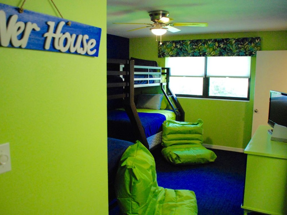 Kids just love our Neon Bunk Room , complete with a Wii game system & bean bags.