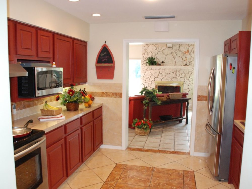 Our all-new gourmet kitchen features top-of-the-line stainless appliances.