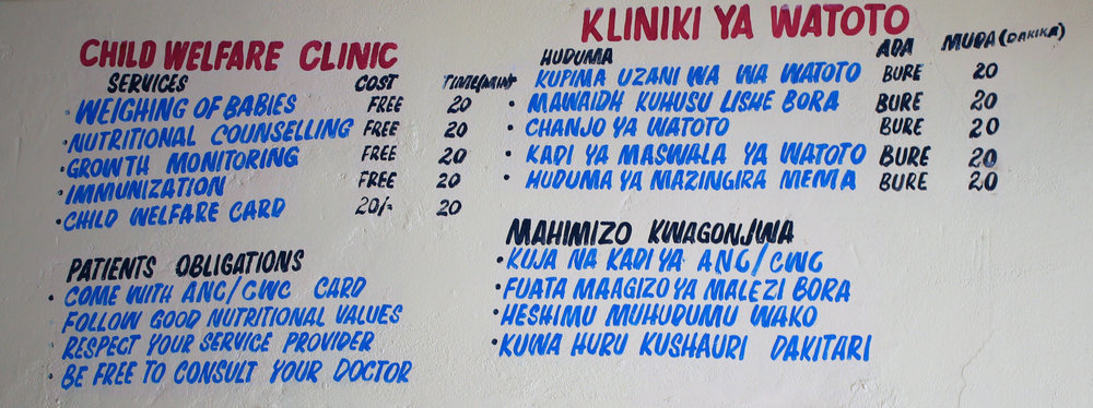 Services are free of charge painted onto the wall outside the clinic.