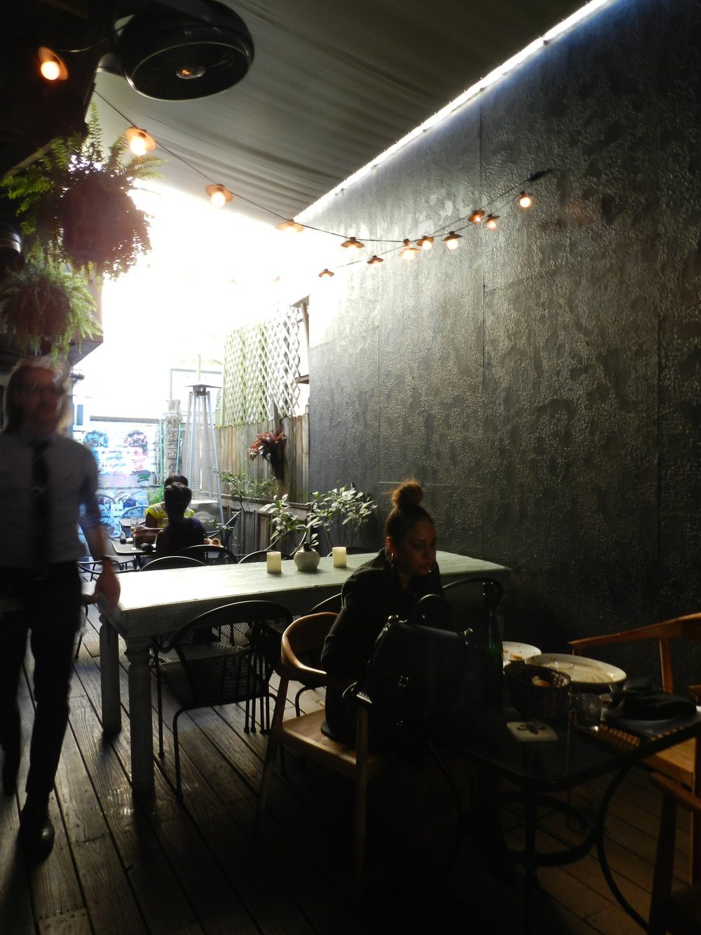 The back patio is an isolated oasis near an otherwise busy section of Magazine Street.