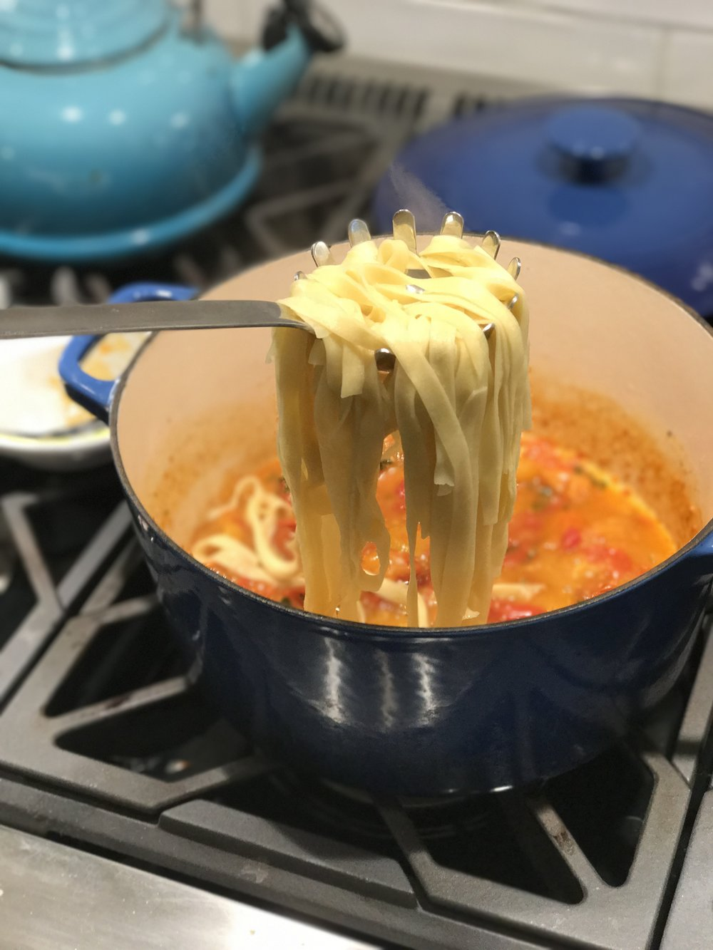 In authentic Italian fashion, I add the cooked pasta directly to the pot of sauce. The pasta water contains starch that will help the sauce stick to the pasta.