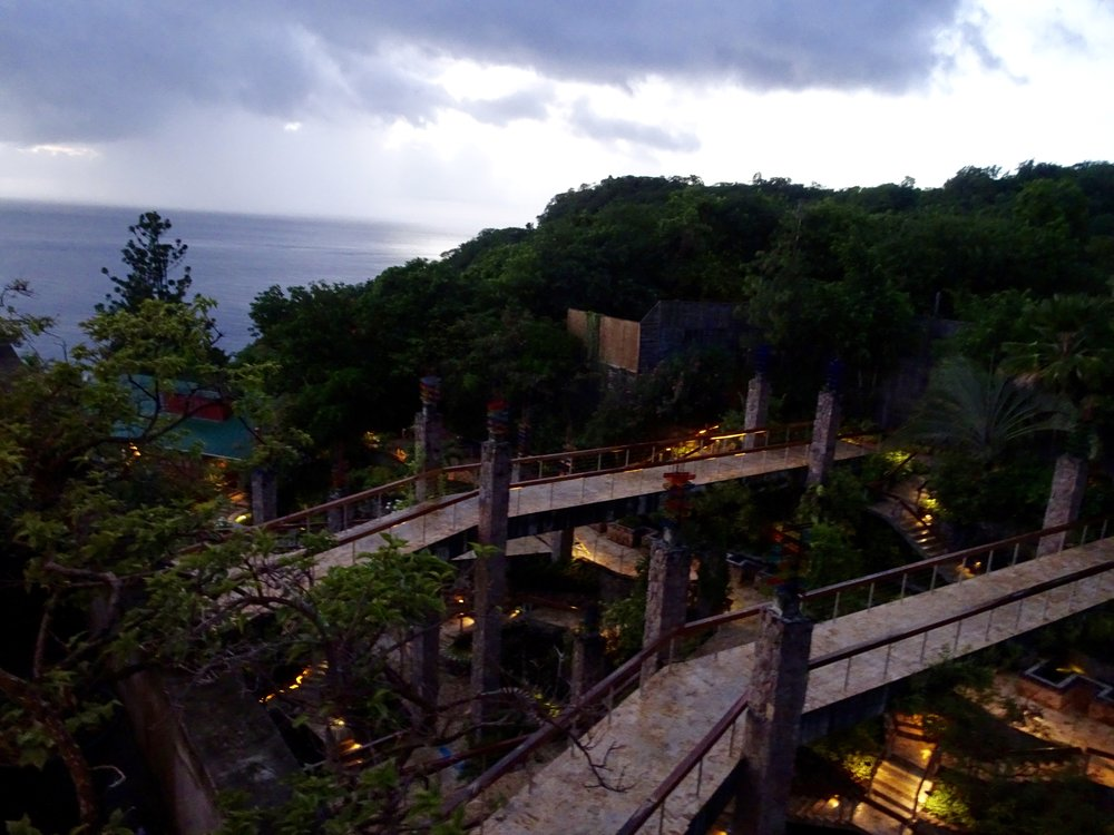 Bridges to Infinity, shown at sunset, connect mountainside with the Jade Mountain's structure and sanctuaries.