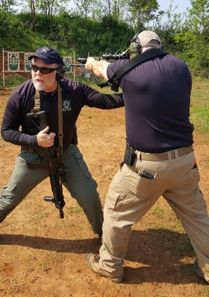Mike demonstrates proper stance and rifle manipulation.