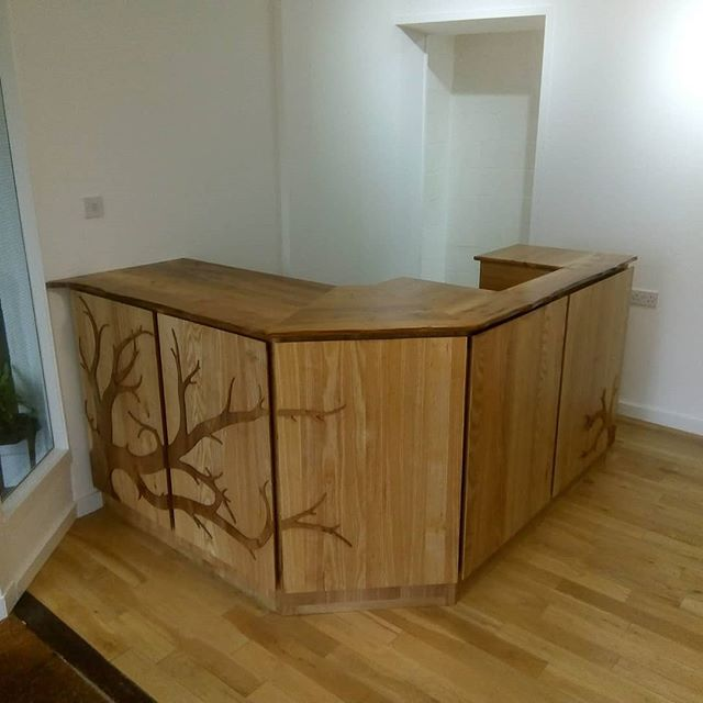New counter installed in West End Gallery, Dundee. This piece was inspired by one of the first cabinets made by Highwood Furniture. This time, instead of inlaying a tree design,  it was fixed onto the front of some 'floating' panels. This helps to give it a more 3D look and really stand out.  The ash panels have a 45 degree chamber on the back edge to aid the floating look. The design is from elm, the same as the counter and desk tops. Oak fronted carcass supports a set of drawers and a computer cupboard with ash panels. Inlayed tree details around desk made from elm.  #bespokefurniture #counter #desk #gallery #customfurniture #unique #inlay #bespokedesign #customwoodwork #elm #scottishwoods #roarockit #oak #ash #beautiful #