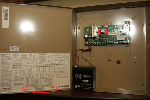 The inside of a 6150 Honeywell Fixed English alarm control box showing the circuit board and schematic - NCA Alarms Nashville TN