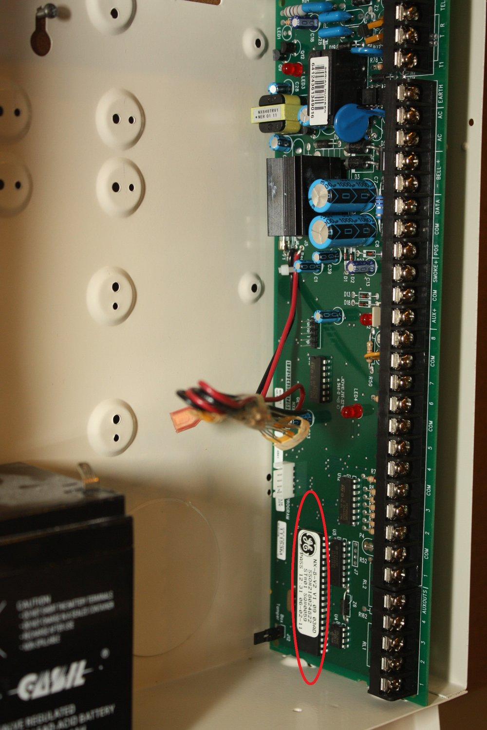 Circuit board for the Caddex NX 1448e Custom Alpha alarm system showing the location of the serial number - NCA Alarms Nashville TN