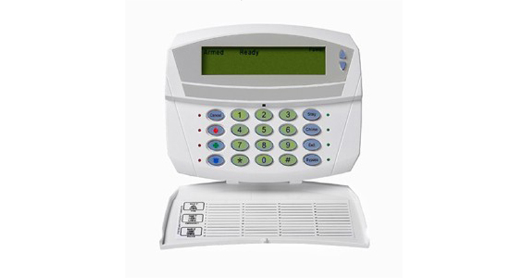 The Caddx NX 1192e Custom Alpha alarm system keypad with the protection cover open - NCA Alarms Nashville TN
