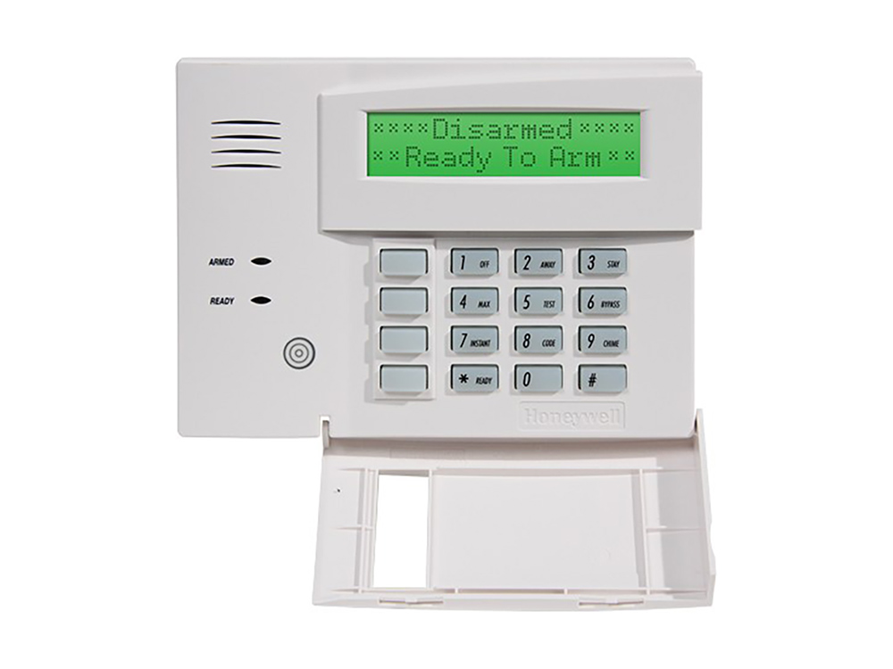 Keypad for the 6160 Honeywell Custom Alpha alarm system with protection cover open- NCA Alarms Nashville TN