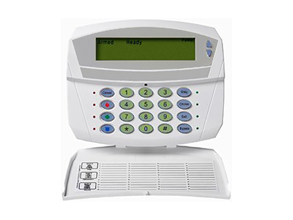 Keypad for the Caddx NX 1448e Fixed English alarm system with the protection cover open - NCA Alarms Nashville TN