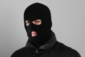 Picture of a burglar in a ski mask