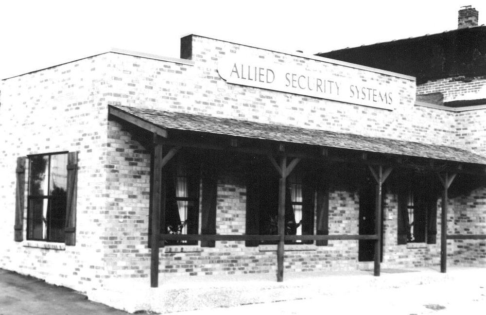New Allied Security Systems building in 1976, brick faced building with porch and covering - NCA Alarms Nashville TN