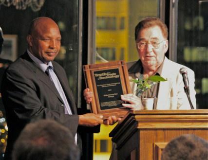 Dr. Gilbert arap Bor being presented the 2011 Kleckner Award by it's namesake, Dean Kleckner.