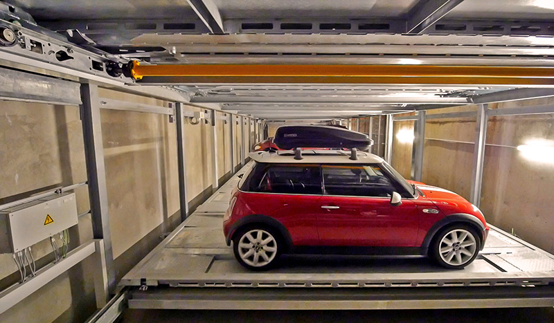 The robotic parking system stores 22 cars on two underground levels. Unlike parking structures, no special ventilation, lighting, or security is required; no elevators, stairs, or fire exits are needed to move patrons; cars are safe from damage, theft, and vandalism; and no vehicle emissions can seep into the building above. (Harding Steel)