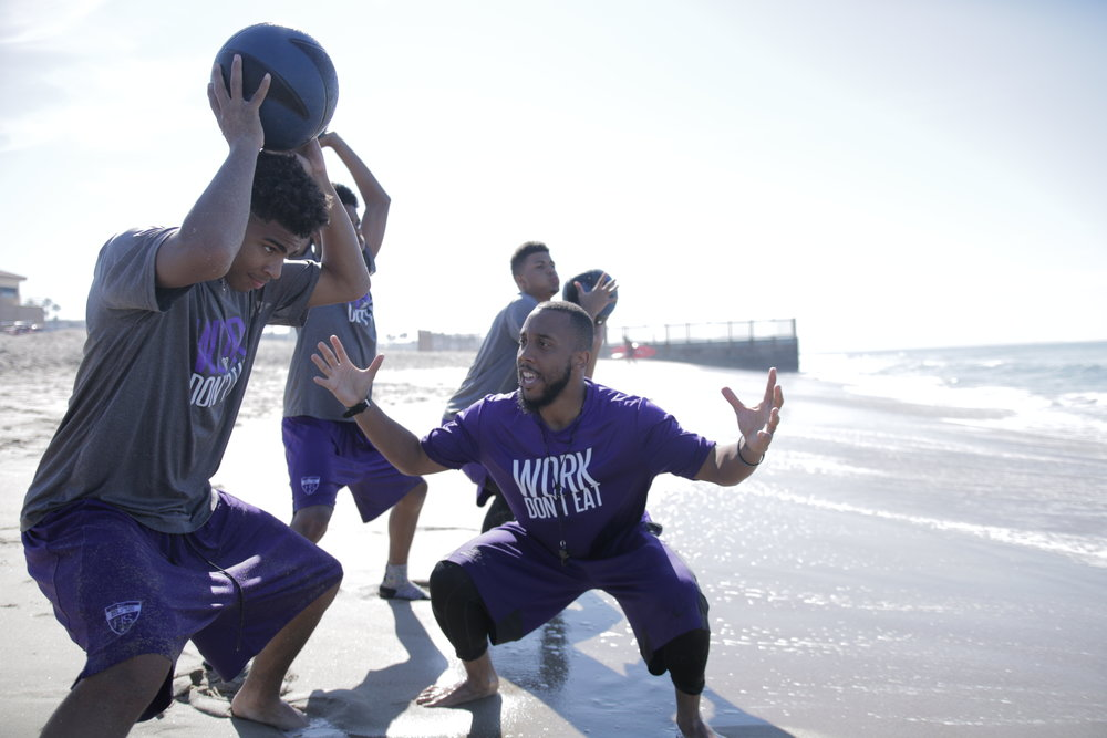 Coach Seagears Pictured motivating and training Durango High School Varsity Boys Basketball team on the beach.