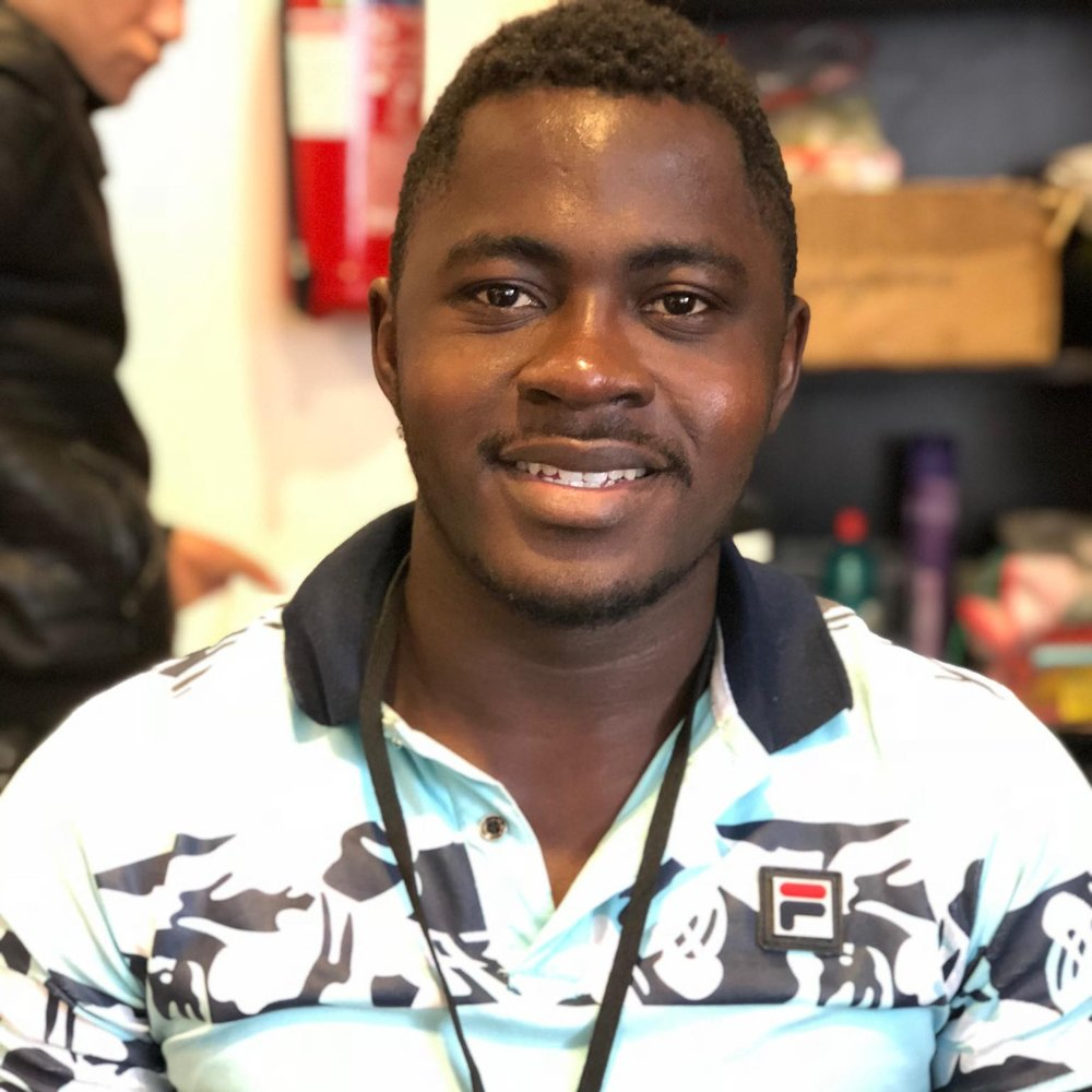 "Brice, 22 - Cameroon   ""Alpha is a place away from the camp, to escape, spend some time, and make friends. My favourite thing to do is work in the laundry station."""