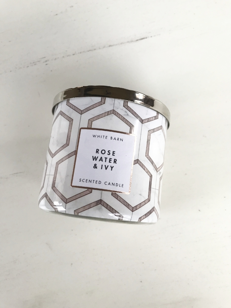 CANDLE - This soy-based wax candle with notes of soft rose petals, rain-kissed ivy, and spring musk is the epitome of summer in a candle. Its light scent is the perfect to help you unwind after a long summer day. This candle is from Bath & Body Works and retails for $24.50.