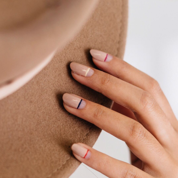 COLOR - Thin colorful lines are one of my favorite nail trends right now. This is the perfect look if you want to add color to your nails, but still be office appropriate. Sleek and sexy, you can't go wrong with this trend.