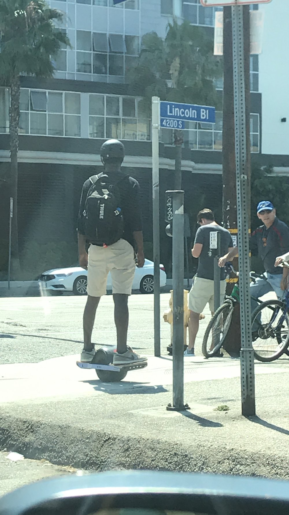 Driving to the Marina when I noticed this guy on this cool, one wheel, hover board type thing. I thought it was EVEN COOLER that he was wearing a helmet. Safety is sexy.