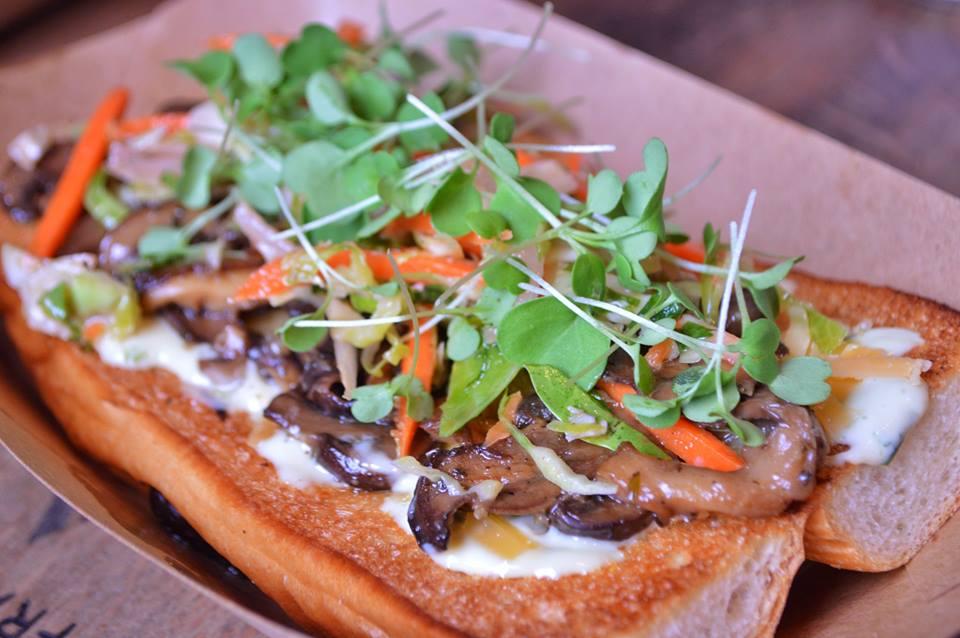 mushroom roll - sautéed oyster, cremini, and shiitake mushrooms,beemster cheese,herb aioli, brussels slaw, Iggy's brioche V*