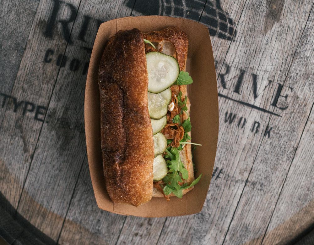bbq chicken sandwich - porter bbq chicken,great hill blue cheese, baby arugula,pickle chips, Iggy's ciabatta
