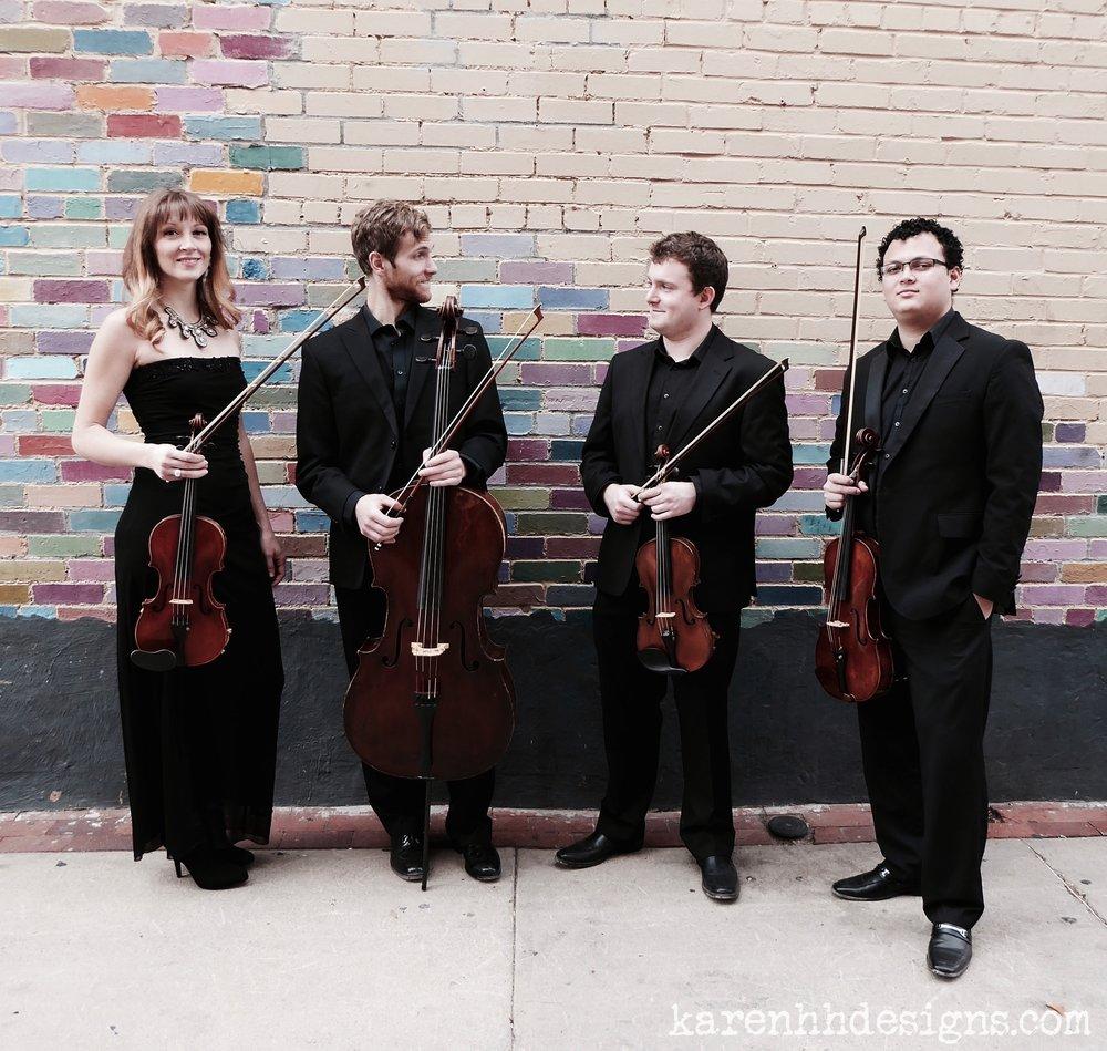 "<a href=""https://concertsinthebarn.org/ajax-quartet""><div style=""color: #465b7d"">Ajax Quartet</div></a>"