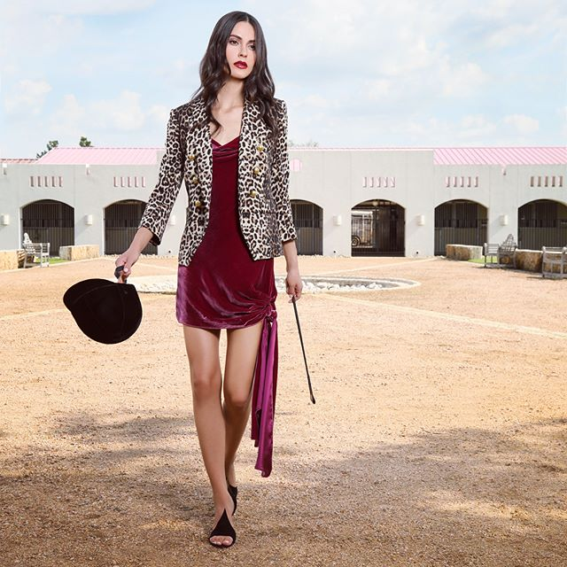 Ready to ride #harashacienda in Magnolia, Texas. @dakotaduffy wears  @intermixonline |  Fall Fashion shoot for @rodistrict | wardrobe styling by @hannahjdotco | makeup by @jenmarinemakeup | hair by @louislopez07 | lighting by @josuesphotos & @rickcarlson3383 | #fashionphotography #fallfashion2018  #red #whatstrending #lusitanostallion #horses #fashionphotography #femalephotographer #velvet #leopardprint