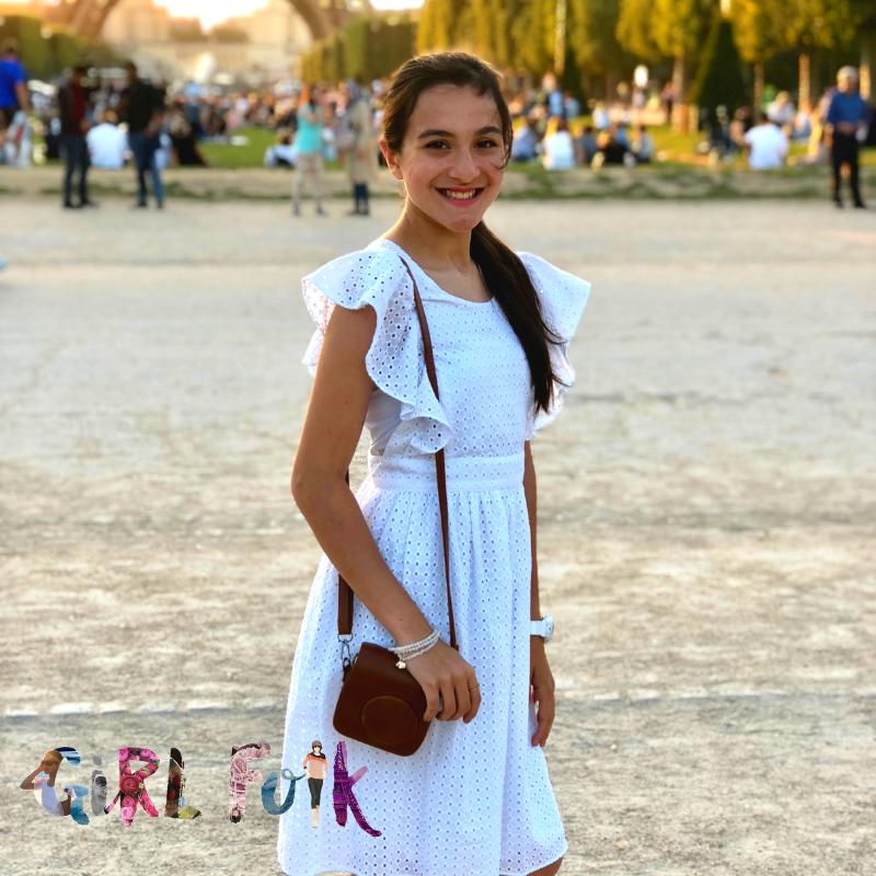 Girl Folk founder Gray, wearing Be The Good Stone Stack Bracelets in Paris