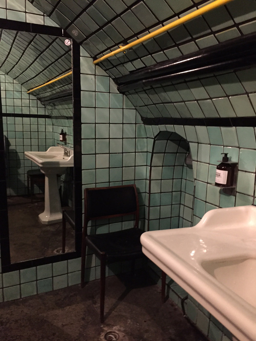 Vintage aqua tiles in the vaulted bathroom.