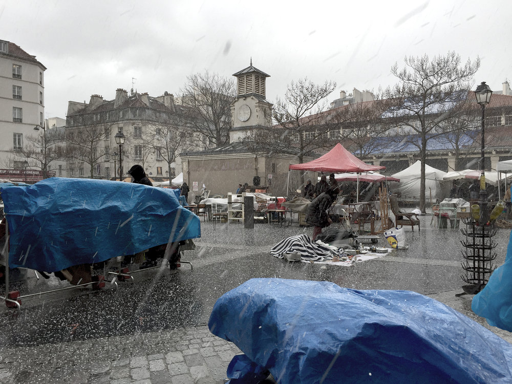 Not a good day for the flea market at place d'Aligre in the 12th arrondissement!